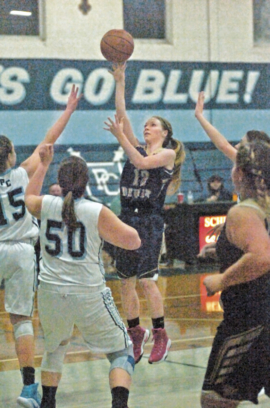 St. Marys' Jenna Nichols shoots a 15-footer during the Blue Devils' 67-63 come-from-behind overtime win against Parkersburg Catholic Thursday inside PCHS. Nichols scored the last five points of overtime to aid the SMHS cause. Photo by Joe Albright.