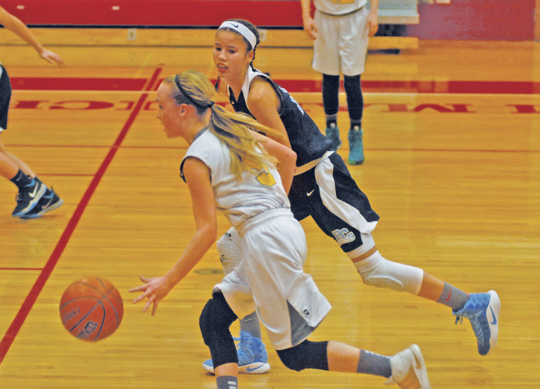 Hamilton's Madison Spears is pressured by Parkersburg Catholic's Aaliyah Brunny during the 7/8th grade Wood County Middle School championship tilt Thursday evening at Memorial Fieldhouse. The Wildcats capped off a 14-0 record by rallying past the Crusaderettes, 47-36. Photo by Jay W. Bennett.