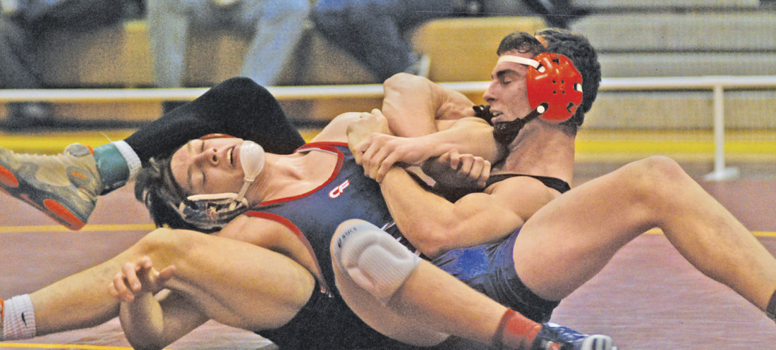 Wirt County's Aaron Life, right, controls Nathan Warden of Independence during the 160-pound finals earlier this season at the Bob Zide Rumble. Life and his teammates are hoping to lead the Tigers to the Class A state title this weekend at Huntington's Big Sandy Superstore Arena. Photo by Jay W. Bennett.