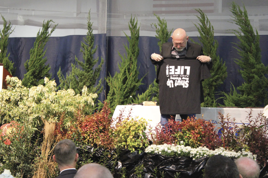 Photo by Janelle Patterson Motivational Speaker Larry Winget displays his T-shirt, 'Shut Up, Stop Whining and Get a Life.'