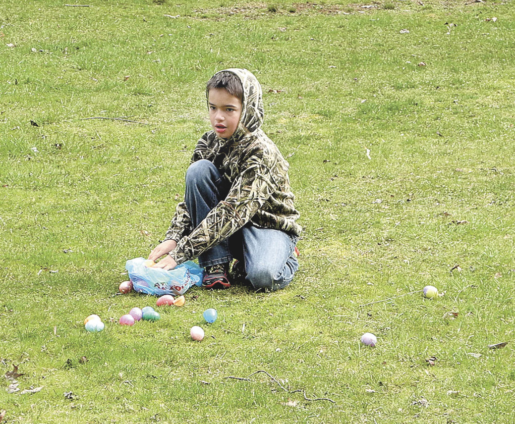 File Photo Bryce Willis of Parkersburg, is surrounded by eggs at last year's Friends of Mountwood Park Easter Egg Hunt. This year's hunt will begin at 11 a.m. April 1 at Mountwood Park.