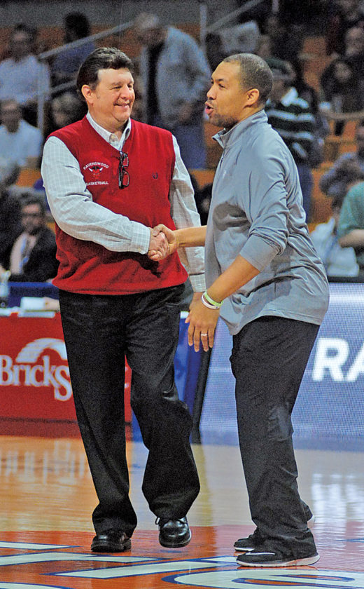 Ravenswood head coach Mick Price and Notre Dame head man Jarrod West shake hands prior to the start of Saturday's Class A state championship game. Photo by Jay W. Bennett.