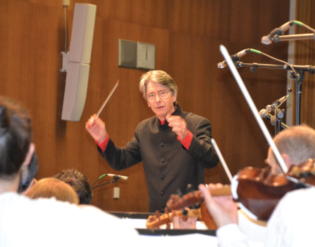 Photo by Brett Dunlap Grant Cooper, conductor and Artistic Director of the West Virginia Symphony, conducts the symphony Sunday during a performance at Blennerhassett School. The performance included many songs made popular by The Beatles.