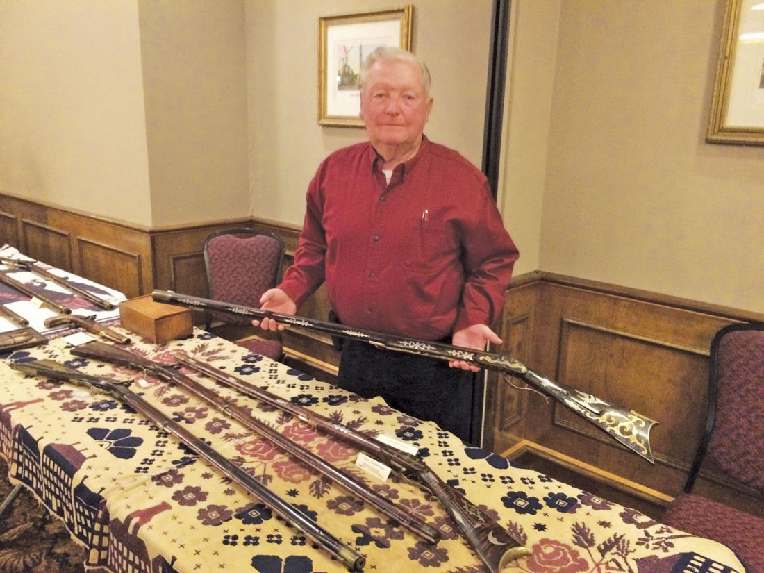 Photo by Brett Dunlap Larry Poston, of Thornville, Ohio, was one of a number of collectors showing their antique long rifles at the Association of Ohio Long Rifle Collectors' 42nd annual exhibition over the weekend at the Lafayette Hotel in Marietta.