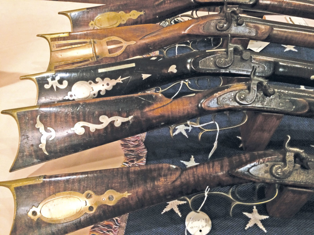 Photo by Brett Dunlap The long rifle collection of Bob Poch of Shadyside, Ohio, featured a lot of detailed workmanship.
