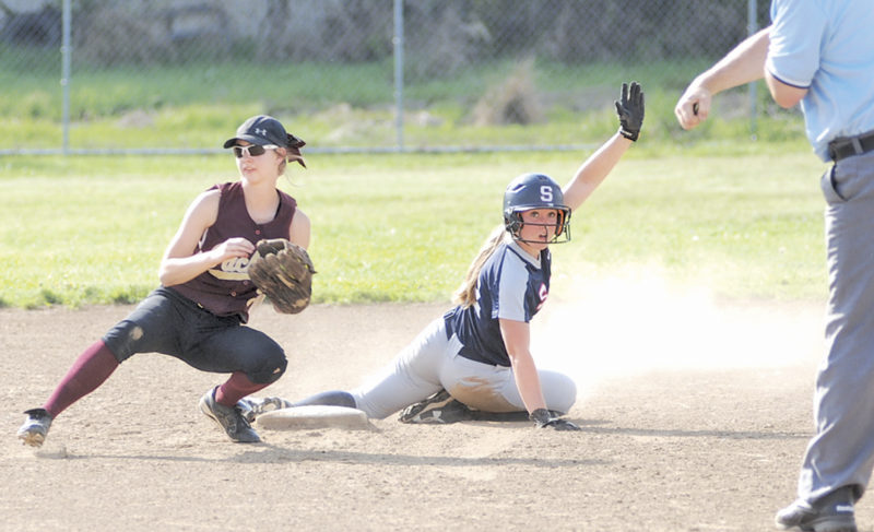 Parkersburg South leadoff hitter Aurora Slusher looks back for the call moments after Williamstown shortstop Courtney Dotson applied the tag for a caught stealing during the third inning of Thursday's game in Williamstown. The host Yellowjackets were upended by the Patriots, 3-0. Photo by Jay W. Bennett.