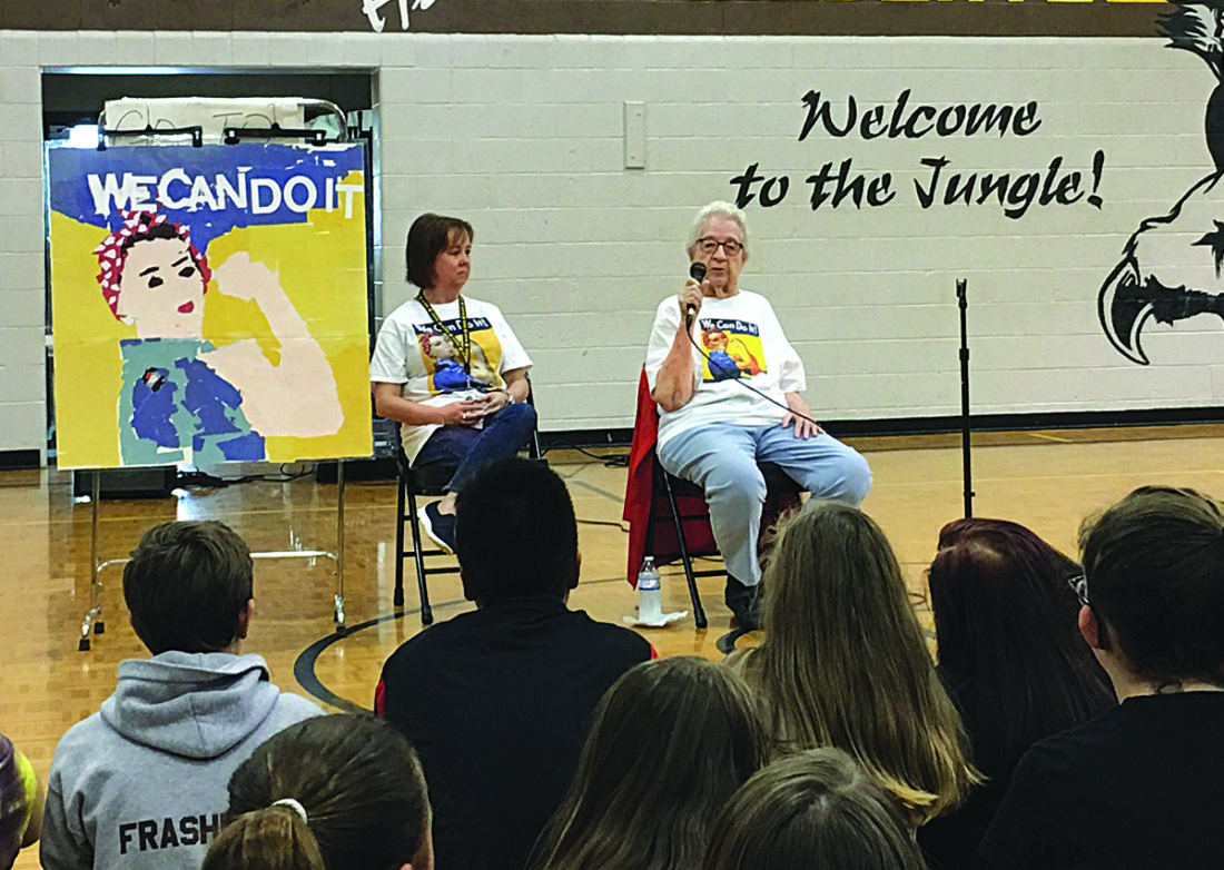 "Photo by Michael Erb Hamilton Middle School teacher Jennifer Furner, left, listens along with students to stories told by Marietta resident Neva Rees, who worked as a ""Rosie the Riveter"" during World War II."