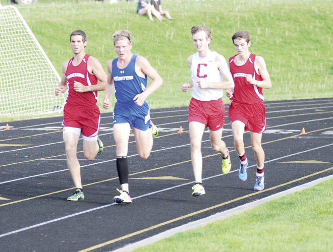 Photo by Jordan Holland  From left to right, Parkersburg's Will LeMaster, Warren's Trent Sayre, Caldwell's Levi's Pemberton, and Parkersburg's Benjamin Lake compete in the 3200 meter run at Friday night's Erickson Invitational.