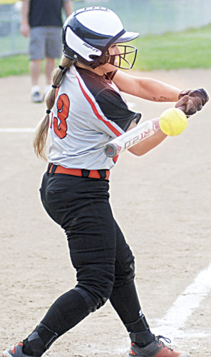 Photo by Jay W. Bennett Wirt County catcher Skylar Bogan gets jammed by Williamstown pitcher Nellie King during Tuesday's softball game in Williamstown. Bogan had a walk-off RBI double in the ninth to give the Tigers a 2-1 victory and clinch a berth in Thursday's Little Kanawha Conference semifinals at Roane County.