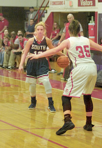File Photo  Parkersburg South's Lexi Moore (12) looks for an open teammate, while defended by Parkersburg High's Madi Mace (35) in a 2016-17 postseason game. Moore committed with Marietta College Tuesday.
