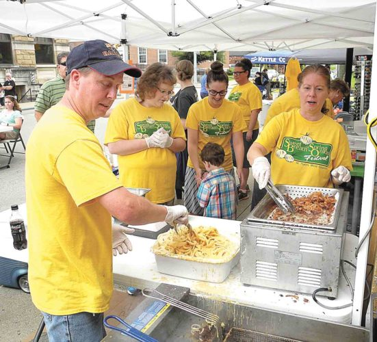 File Photo Making onion rings for last year's Sweet Breath of Life Vidalia Onion Festival in St. Marys were from right, Troy Winland, Olivia Sparks, Halle Metz, Kable Sparks and Sonya Adams. This year's event will be Saturday in downtown St. Marys.