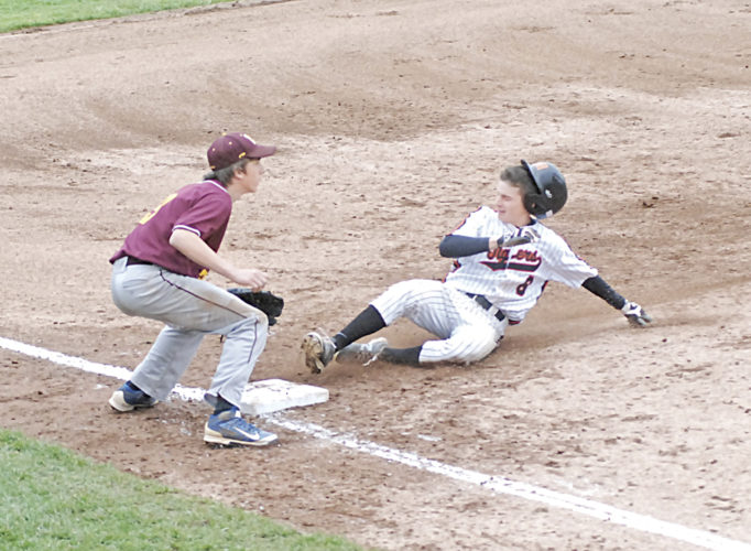Marietta's Turner Hill slides safely into third base as Meigs' Tyler Johnson awaits a throw after Hill's bases-clearing triple in the fifth inning of a high school baseball sectional final Thursday at Legion Field. Marietta won, 10-0. Photo by Jordan Holland.