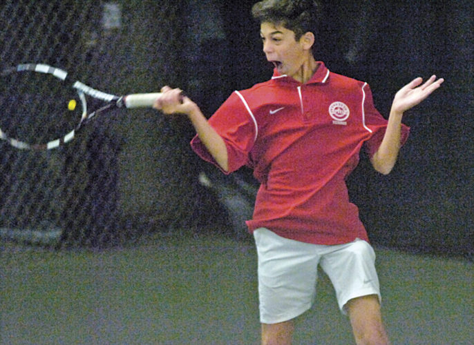 Parkersburg High's Seena Saadevandi hits a shot during a rally in his No. 1 doubles state quarterfinal match with partner Zarion Jones during the Big Reds' 9-7 win over Washington's top pair Friday at the Class AAA tennis state tournament. Photo by Joe Albright.