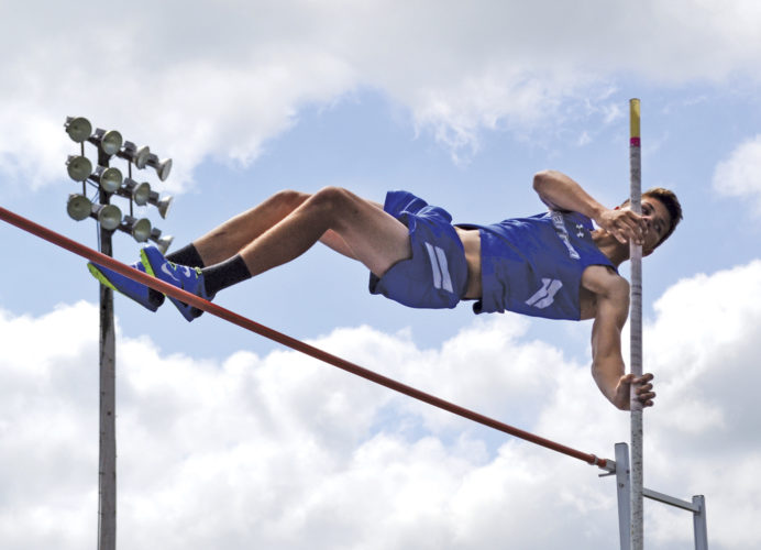 Warren's Liam Kellar finished first in the boys pole vault, clearning the bar at 11 feet, at the SEOAL track and field championships Saturday at WHS. Photo by Ron Johnston.