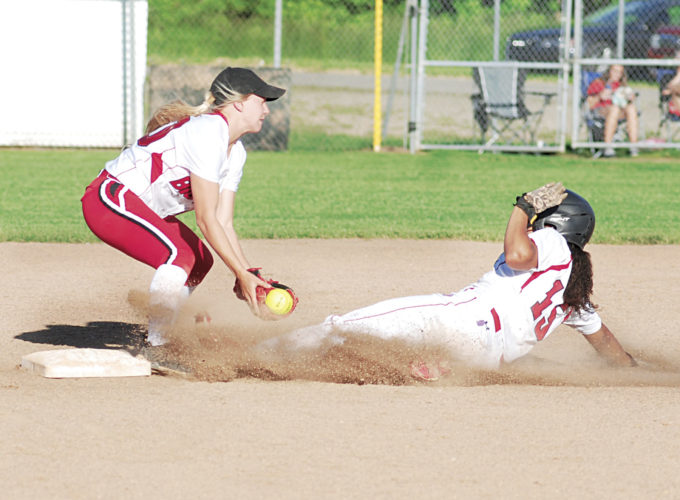Photos by Jay W. Bennett Hurricane's Kiersten Landers touches second base with her cleat just before Parkersburg shortstop Rylee Boggess can apply the tag during the third inning of Monday's Class AAA, Region IV best-of-three tournament game at Godbey Field. The Redskins defeated the Big Reds in six innings, 14-0.