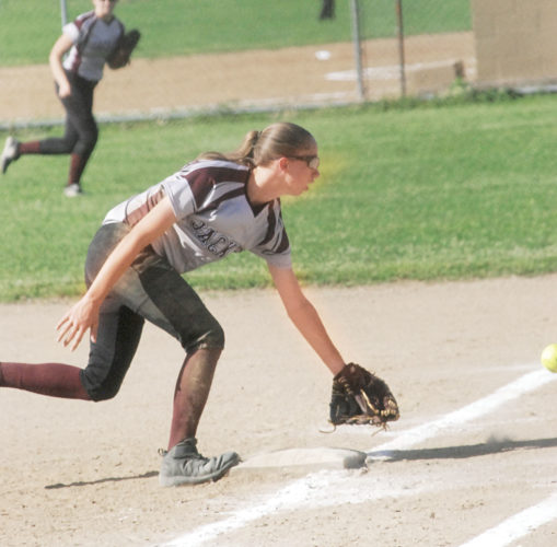 Williamstown first baseman Keely Alsup makes a stab at a grounder hit down the first-base line during the Yellowjackets' 2-0 loss over Sherman Monday in teh Class A, Region IVtournament.  Photo by Steve Hemmelgarn