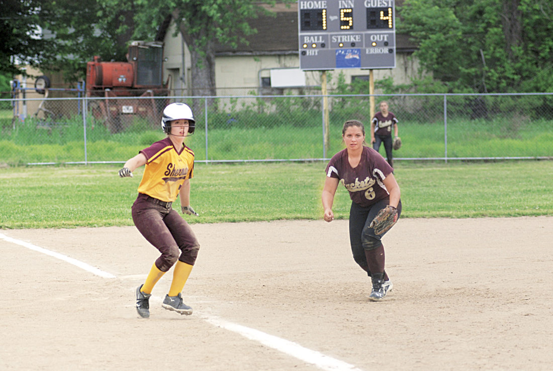 Photos by Steve Hemmelgarn Williamstown's Kayla Scott keeps Sherman's Sydnee Ferrell close to third base during the Tide's 6-2 win over the Yellowjackets in a Class A, Region IVsoftball tournament game Wednesday in Williamstown.