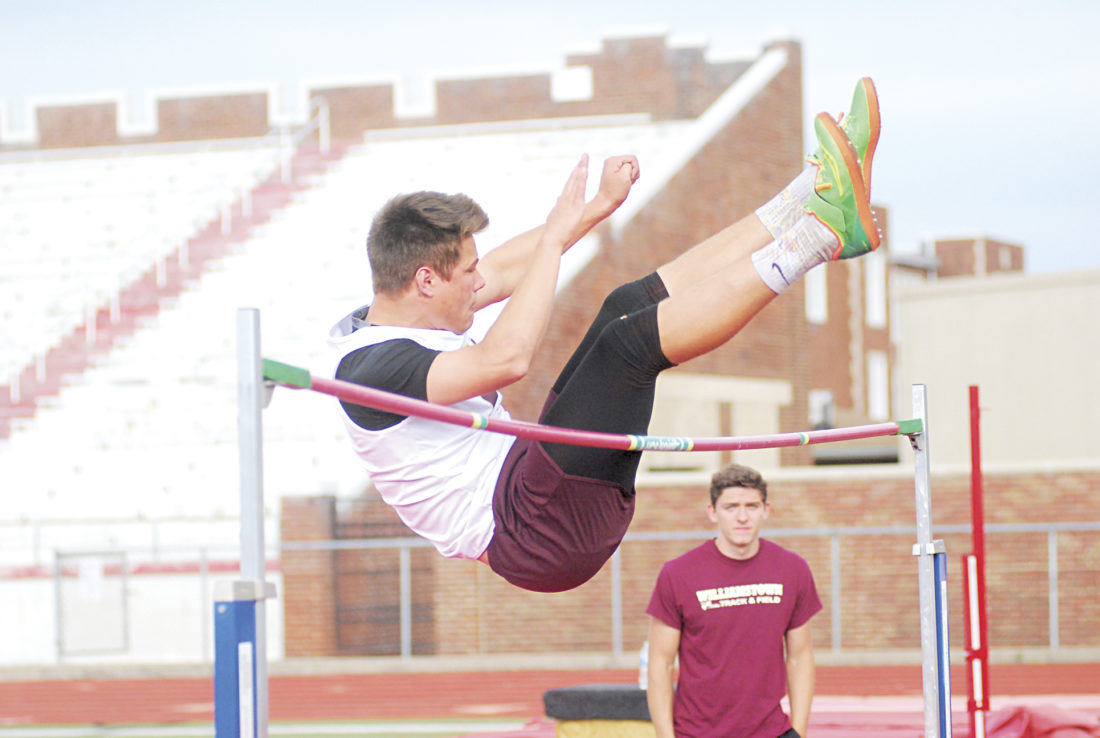 Williamstown's Trevor Hoosier competes in the high jump earlier this season. Hoosier will be an integral part in the Yellowjackets' quest for a second straight Class A track and field state title when action starts Friday.  Photo by Jay W.  Bennett