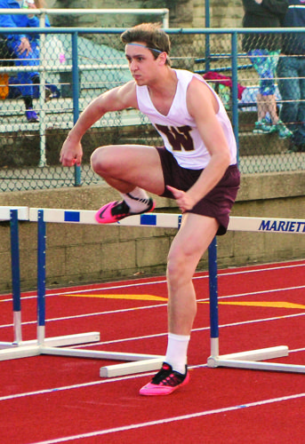 Photo by Jordan Holland Williamstown's Tim Wickham competes in a hurdles event during the Marietta Night Relays earlier this season at Don Drumm Stadium.