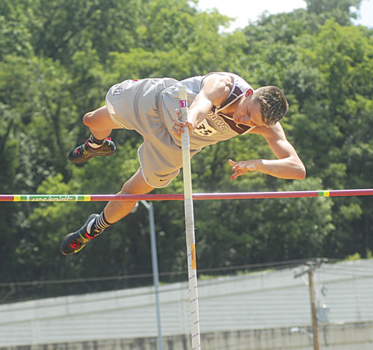 Roane County's Haden Coon clears the bar during Class AA state pole vault action Saturday at University of Charleston Stadium. Coon finished with a top mark of 13 feet, 6 inches to become a state champion. Photo by Jay W. Bennett.