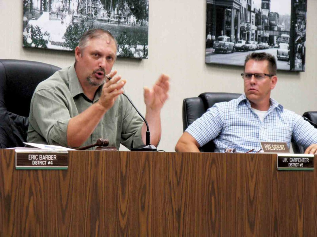 Parkersburg City Council President J.R. Carpenter speaks about his objection to the proposed investment policy as Councilman Mike Reynolds listens. (Photo by Jeffrey Saulton)