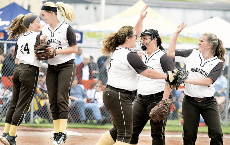 John Marshall High School's teammates, from left, Abby Blake, Carli Lightner, Madison Mayle, Lauren Garcia and Hannah Morris celebrate following a strikeout late in the game against George Washington High School Wednesday in the opening round of the West Virginia Class AAA State Tournament in Vienna. Photo by Jeff Baughan.