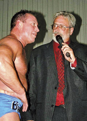 Dave Parsons of Jadat Sports, right, interviews wrestler Brad Armstrong. Jadat Sports is  promoting Clash for the Cause All-Star Championship Wrestling at 7 p.m. June 3 at  Parkersburg Catholic High School to benefit the Alzheimer's Association.  Parsons was  diagnosed with dementia, caused by a dozen  concussions, in  October.  Photo provided