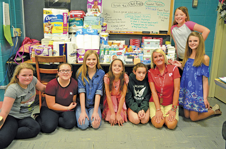 Photo provided Jackson Middle School students who participated in the personal care items drive, from left, are Emily Bond, Katie Riggs, Kayleigh Johnson, Lillian Floyd, Izzy Farinash, teacher Kecia Garner, Lakyn Campbell and Abby Hines.