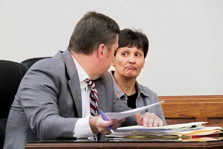 Maria Ann Clark, 53, of 409 N. Seventh St., Marietta, listens to her attorney Eric Fowler in Judge Mark Kerenyi's court Thursday. (Photo by Janelle Patterson)