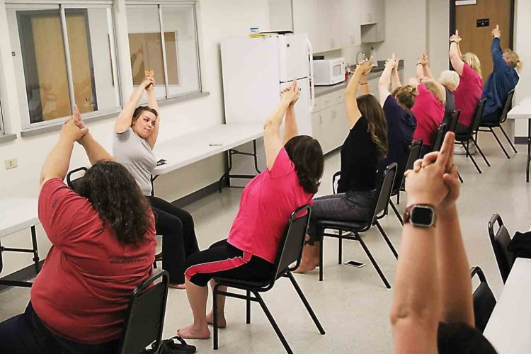 R.S.V.P Americorps volunteer Stacey Steed teaches chair yoga to the Prevent T2 diabetes prevention class with the Washington County Health Department. (Photo by Janelle Patterson)