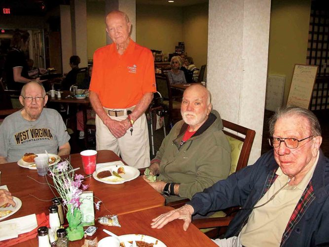 Eating lunch together Saturday at The Wyngate Senior Living Community in Parkersburg are, from left, Earl Lindamood, Fred Fitzer, Roger Lewis and Bill Butcher. (Photo by Paul LaPann)