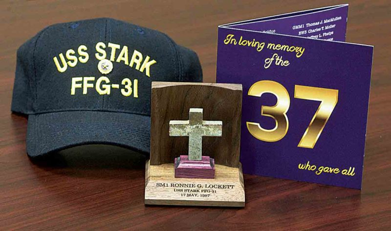 A hat, memorial cross and card were presented to family at the May 17 memorial service. (Photo by Jeff Baughan)