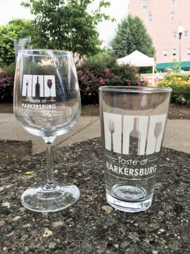 File Photo Visitors to the Taste of Parkersburg receive a wine or beer glass for sampling the different beverages.