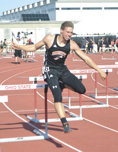 Marietta High's Travis Moore clears a hurdle during the 300 hurdles finals at Saturday's state meet at Jesse Owens Memorial Stadium in Columbus. Moore finished in 38.80 to place seventh in Division I. Photo by Jordan Holland.