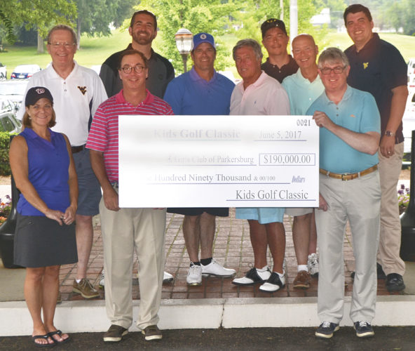 Photos by Jordan Holland A check for $190,000 is presented to the Boys and Girls Club of Parkersburg following the 21st annual Kids Golf Classic Monday at the Parkersburg Country Club.