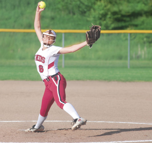 Photo by Jay W. Bennett  Parkersburg's Alyssa Gates tosses a pitch during a Big Reds' regional matchup against Hurricane earlier this year. Gates recently committed to pitch for Ohio Valley University.