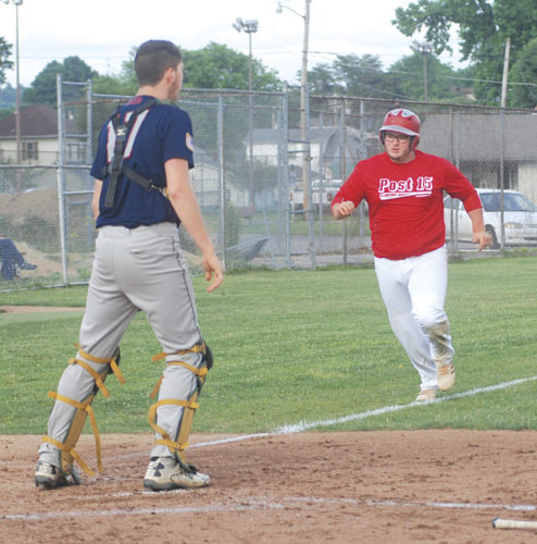 Parkersburg Post 15 first baseman Wade Garrett sprints home following his triple to score on teammate Josh Stephens' sacrifice fly RBI in the fourth inning while Athens Post 21 catcher Kaleb Hill looks on. Athens won the first game of Wednesday's twinbill 4-1. Photo by Jay W. Bennett.