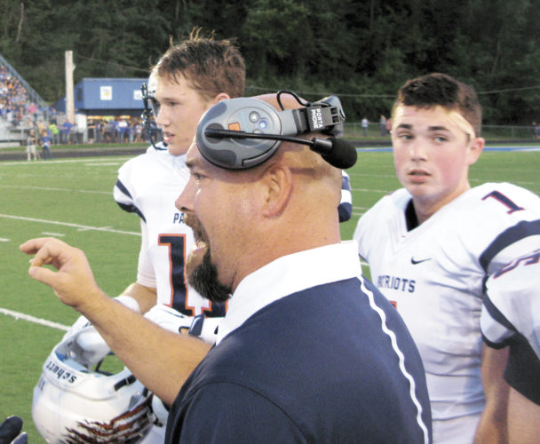 Parkersburg South coach Mike Eddy speaks to his players during a high school football game last season.