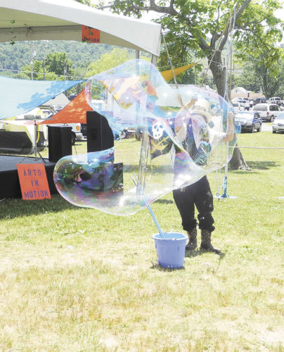File Photo John M. Gradwohl Jr., also known as Professor Phineas T. Bubblemaker, performed during last year's Mid-Ohio Valley Multi-Cultural Festival in City Park.