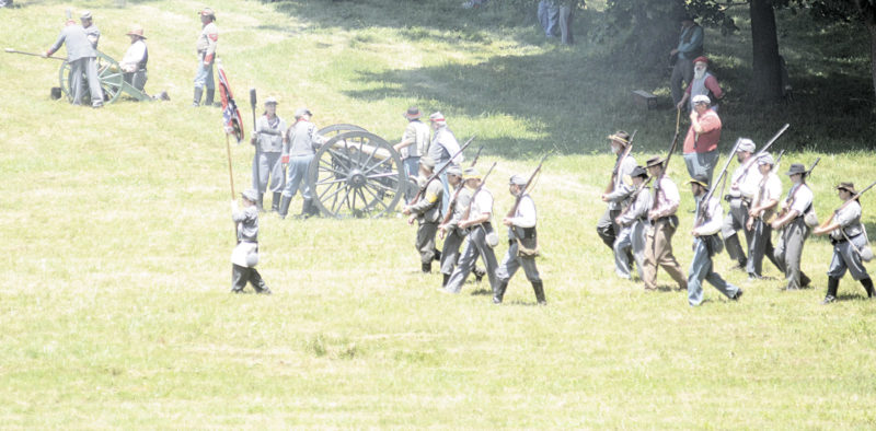 File Photo Civil War re-enactors perform a battle last year near Henderson Hall to commemorate West Virginia becoming a state during the Civil War. This year's event will be Saturday and Sunday.