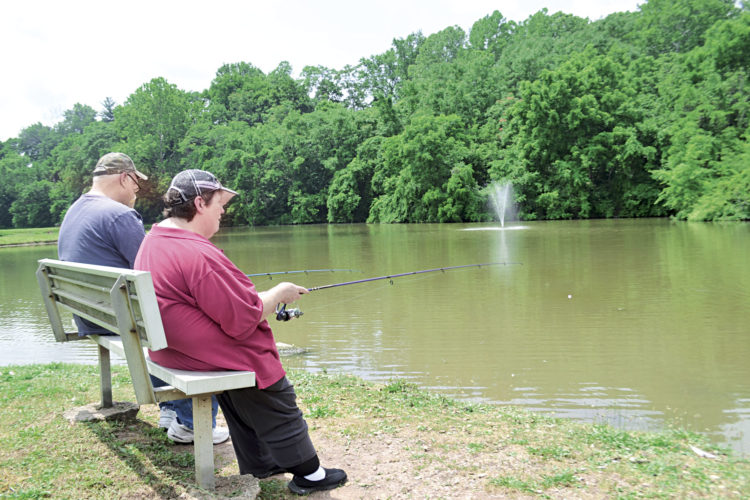 Photo by Peyton Neely Newport residents Arden Wince and his wife Ginger get some fishing done at Buckeye Park's pond on Wednesday in Marietta. The pond will be the site of the annual Kids Fishing Derby on Saturday.