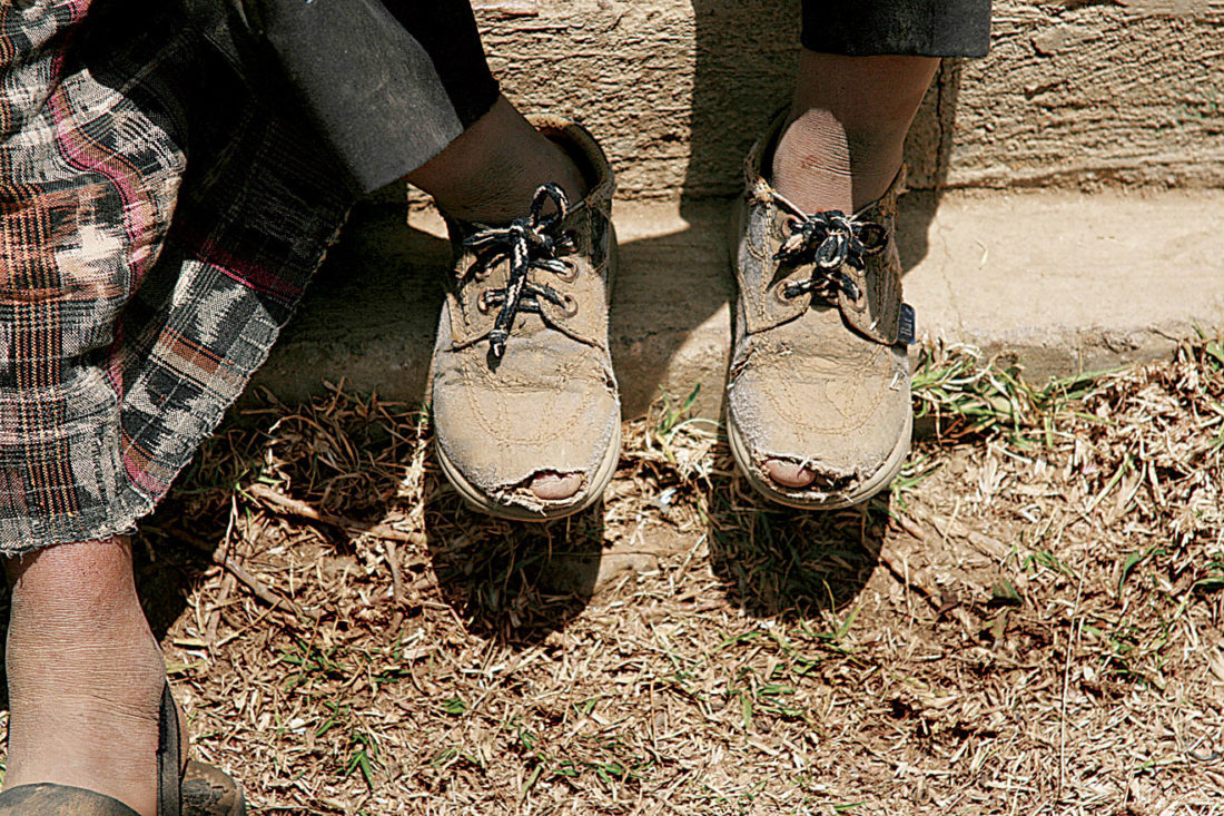 Photo Provided A worker goes through the day, wearing shoes which don't fit, as they work the fields around Guatemala City.