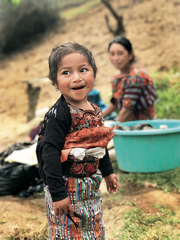 Photo Provided A young Guatemalan girl flashes a smile at the work party.