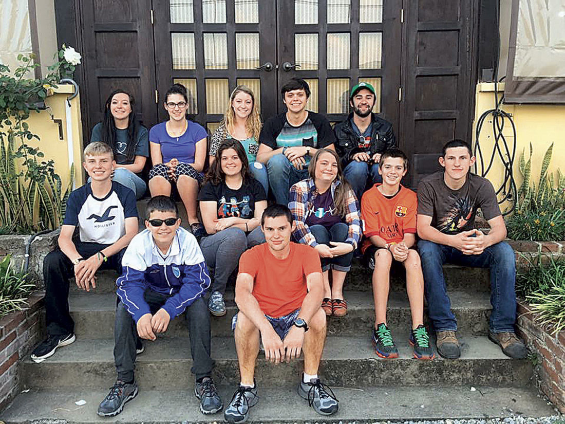 Photo Provided Some of those making the trip to Guatemala were: front row, from left: Lucas Fullerton, Duncan Watson. Middle row, from left, Eli Fullerton, Courtney Feight, Peyton Smith, Evan Wells, Connor Watson. Back row, from left: Mikayla Roberts, Sarah Watson, Alexis Groves, Seth Feight, Tom Middleton.