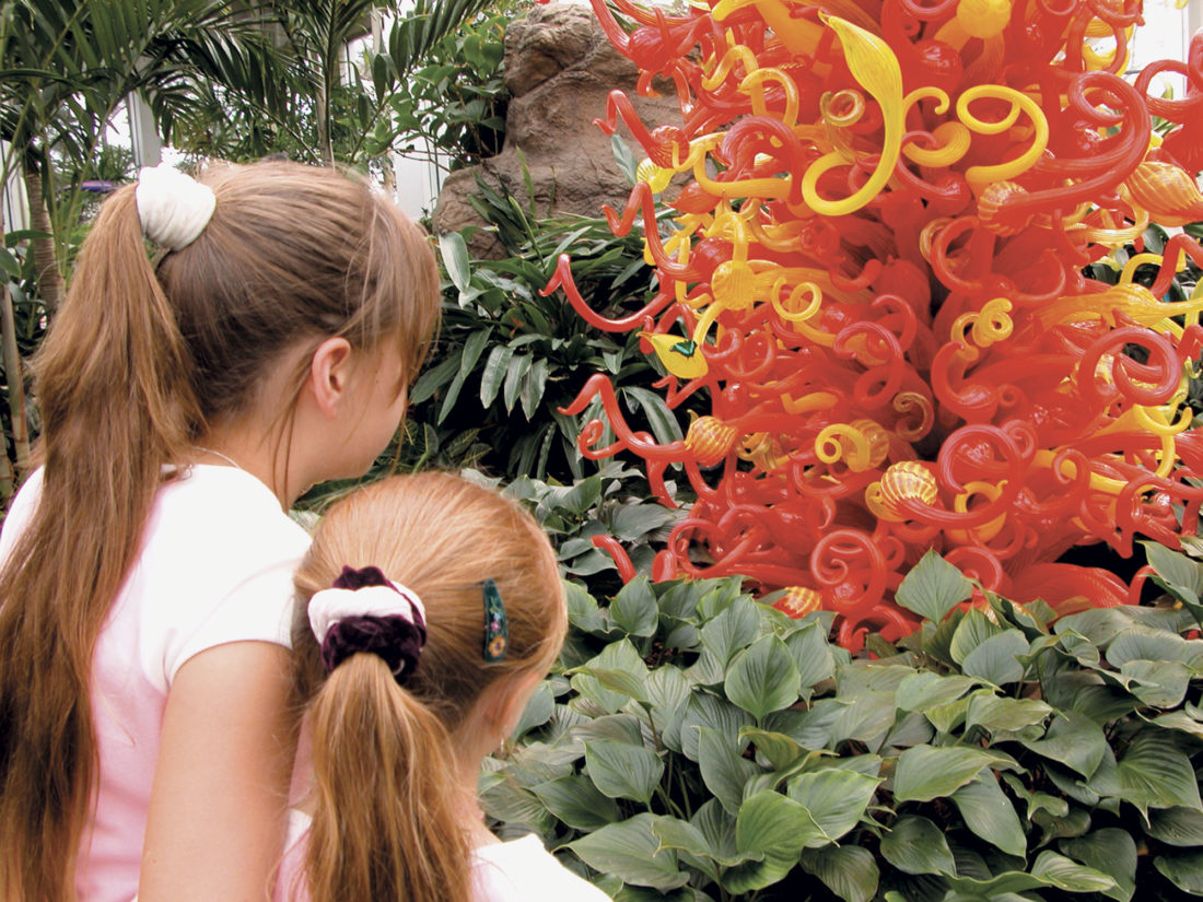 Photo courtesy ExperienceColumbus.com Children look  at a glass sculpture at the Franklin Park  Conservatory.