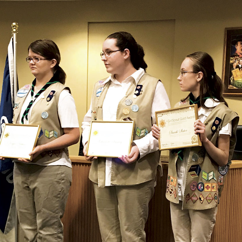 Photo Provided Three Girl Scouts in Belpre were recognized in May with the highest award in Girl Scouting, the Gold Award. From left are Kayla Arthurs, Charlotte Bailey and Sarah Slater.