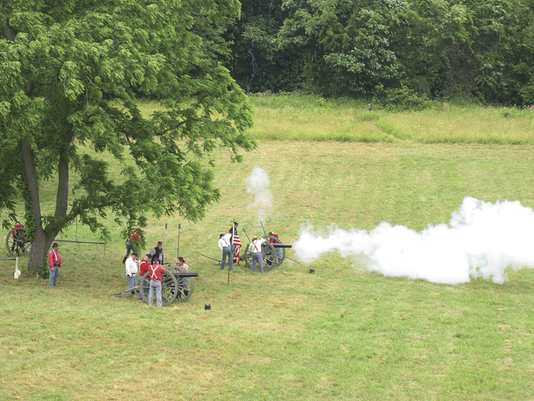 Photo by Wayne Towner Noise and smoke filled the air as cannons fired during a simulated battle between Union and Confederate soldiers on Sunday during the Civil War Re-enactment Weekend at Henderson Hall in Boaz.