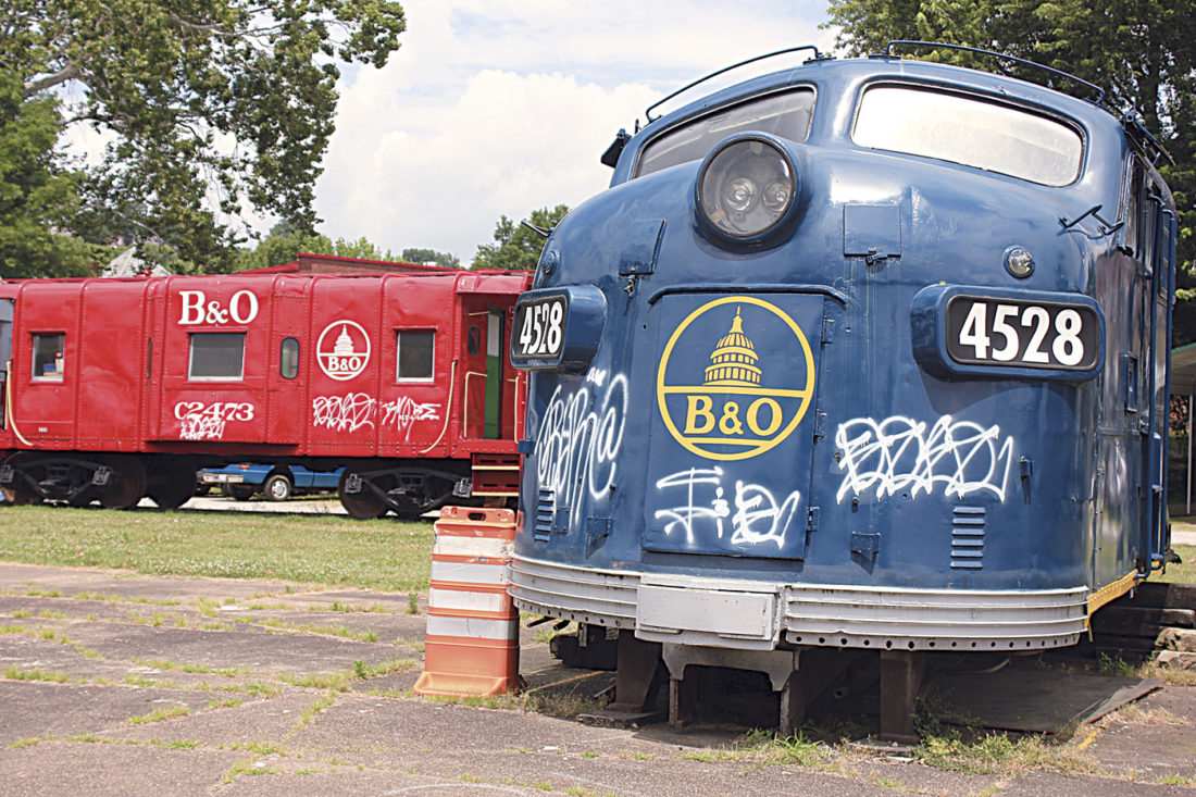 Photo by Janelle Patterson Graffiti is scrawled across the front and side of B&O rail cars in Harmar Friday