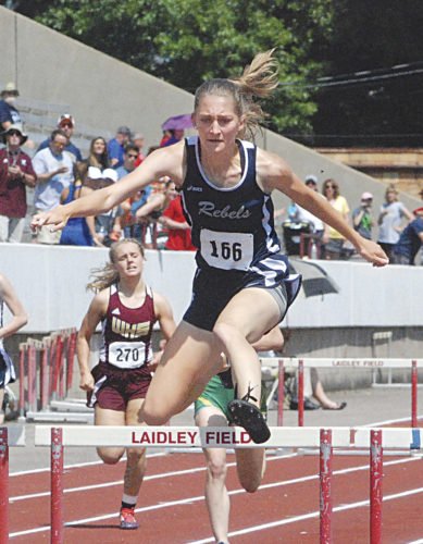 Ritchie County's Samantha Kirk, pictured here going over the final 300 meter hurdle during the Class A state track meet where she established an all-time best mark of 45.15, will continue her track career for Davis & Elkins College. Photo by Jordan Holland.