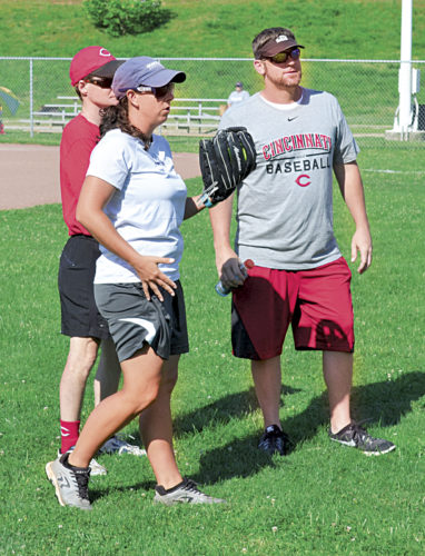 Photos by Ron Johnston Instructors Jenn Castle and Scott Williamson chat at the 24th annual Cincinnati Reds Legends Youth Baseball/Softball Clinic at Jackson Park in Vienna.